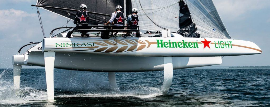 DNA-Performance-Sailing-TF10-foiling-trimaran-flying-on-the-water